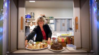 Winter Shelter volunteer Janine Ryan serves dessert at Heathmont Baptist Church.