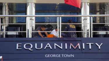 Indonesian police officers are seen on board the luxury yacht Equanimity off Bali.
