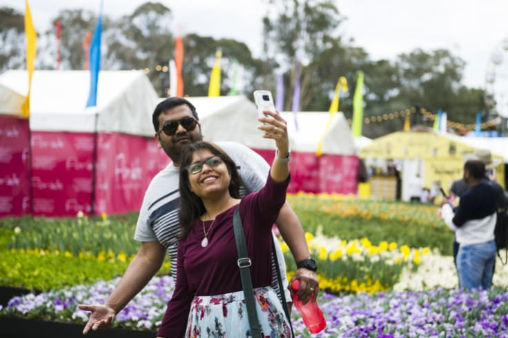People come to take selfies in front of the flower beds at Floriade.