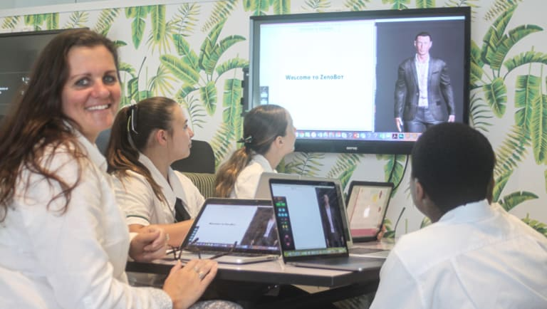 Trinity Lutheran College's Kirsten Ford teaches alongside Zenobot.