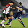Victory's Marco Rojas (right) battles with FC Seoul's Cho Young.