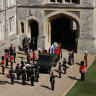 Members of the 1st Batallion Grenadier Guards place the coffin of Prince Philip onto a Land Rover outside Windsor Castle.