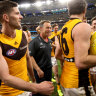 Alastair Clarkson and the Hawks celebrate after beating the Eagles.