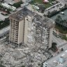 An aerial photo shows part of the 12-storey oceanfront apartment building that collapsed.