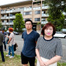 Robin Son, left, Mihi Chung and other owners of the Lidcombe apartment building.