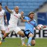Sydney's Luke Brattan and Yokohama F. Marinos' Daizen Maeda compete for the ball.