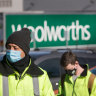 Woolies liquor warehouse workers walk off the job after new virus case