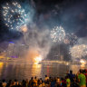 Night sky lights up for New Year's Eve as crowds flock to Brisbane River