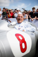 Sir Stirling Moss sitting in his Mercedes before driving up the hill at Goodwood on June 27, 2015 in Chichester, England.