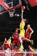 Nathan Sobey drives to the basket and had a big impact for the Boomers