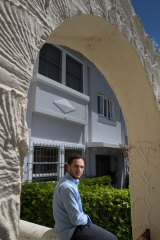 Marc Burman, 20, in front of an apartment building in Bondi, in which he has invested through the BrickX platform.