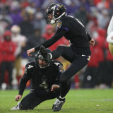 Tucker launches the kick that sealed the win for the Ravens.