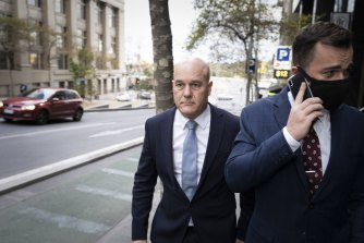 Xavier Walsh, left, leaving the royal commission last month.