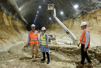 Transport Minister Andrew Constance, left, and Premier Gladys Berejiklian inspect one of the station sites last year.