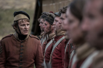 Damon Herriman plays Ruse, a nasty, pandering stooge to brutal camp commander Hawkins.