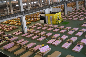 Health authorities race to set up an 1800-bed field hospital inside a cargo building in Don Mueang International Airport in Bangkokas COVID-19 cases and deaths soar.