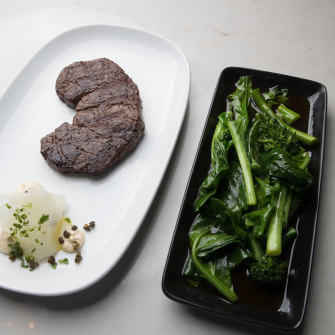 The dry-aged Porterhouse and stir-fried greens.