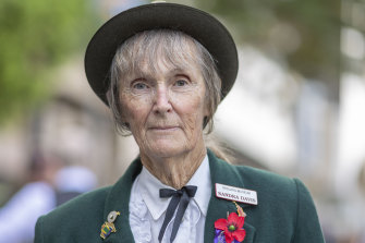 Sandra Davis poses with her father's war medals during the Anzac Day parade in Brisbane on Thursday.