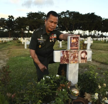 Major General Cirilito Sobejana, the recipient of the medal of valor, pays his respects to one of his men who died in the Battle of Marawi and is buried at the National Hero's Cemetery in Manila, Philippines.