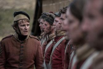 Damon Herriman plays Ruse, a nasty, pandering stooge to brutal camp commander Hawkins.