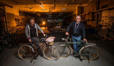 Finish line: Brothers Trevor and Geoff Hope at their Footscray shop, Ted's Cycles, which will close after 83 years on Friday.