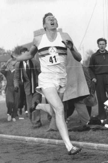 Roger Bannister hits the tape to break the four-minute mile in Oxford, England.