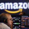 Amazon soars to help send the Nasdaq above 9000 for first time