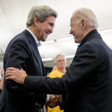 Close friends: John Kerry on the campaign trail with Joe Biden in Iowa in February.