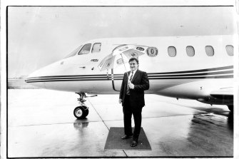 John Elliott with the IXL company jet at Essendon Airport in 1987.
