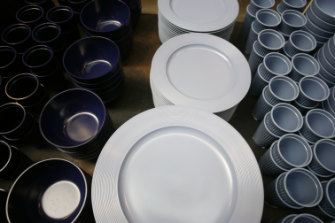 Biodegradable plastic dinner plates and cups on display at Merci, a concept shop in Paris.