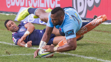 Inside the chalk: Taqele Naiyaravoro adds to the Rebels' pain with another try.
