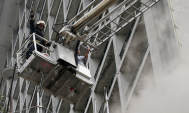 A trapped employee is rescued from the Manila Pavilion Hotel.