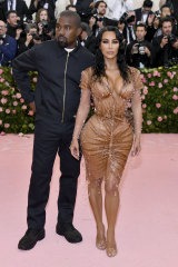 """Kim Kardashian, with Kanye West at this year's Met Gala, has a """"solutionwear"""" line."""
