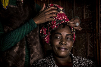 Margaret Tong is one of a number of female refugees from north and south  Sudan who have recently found full-time employment.  At a workshop to celebrate their success, they had an African head wrapping session.