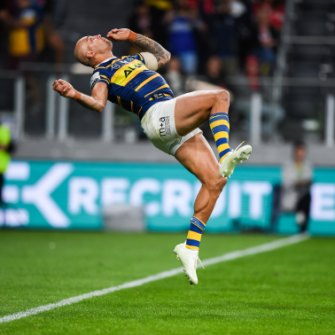 Flipping out: Blake Ferguson performs a back flip after scoring a spectacular try in the Eels win at Bankwest Stadium.