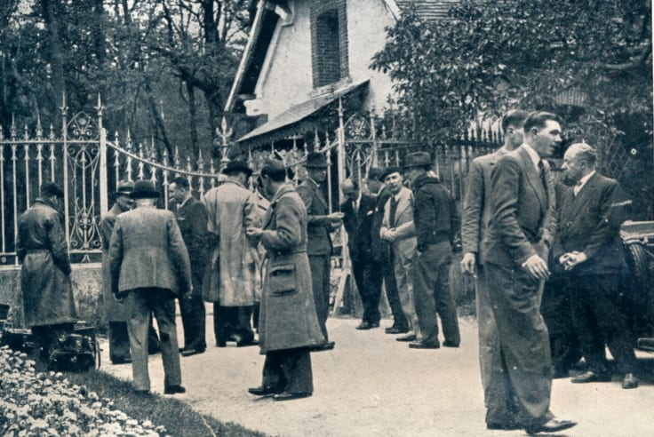 Photographers and journalists gather at the main entrance to the gates of the Chateau de Cande, the location of the wedding between Wallis Simpson and the abdicated King Edward VIII.