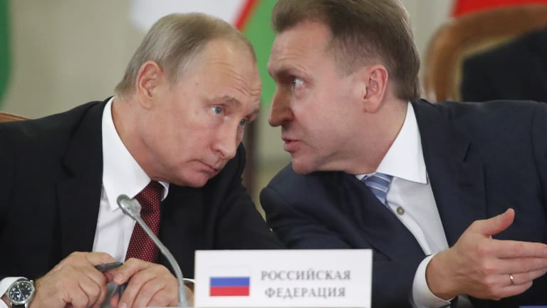 Vladimir Putin, left, and Russian First Deputy PM Igor Shuvalov.