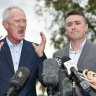One Nation party officials Steve Dickson (left) and James Ashby field questions during a press conference in Brisbane, Tuesday, March 26, 2019. The pair have been caught in an al-Jazeera investigation which used hidden cameras and a journalist posing as a grassroots gun campaigner to expose the far-right party's extraordinary efforts to secure funding in Washington DC in September.