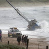 Yacht stranded on Wanda Beach after crew loses control in wild winds