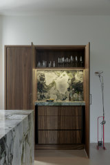 This stone in this St Kilda apartment is called Ice Green and comes from a Chinese quarry.