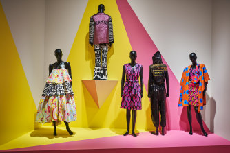 Piinpi's Blak and deadly, Urban street wear, from left:Arkie Barton's Rainbow dreaming dress, 2015, and Dreamtime jacket and Spinifex flares, 2015; Shannon Brett's Femme gem dress, 2020; Teagan Cowlishaw's Deadly kween jumpsuit, 2019;Shannon Brett's Femme gem pants, top and bag, 2020.