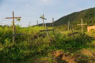 Crosses remember the dead of the Samarco dam disaster in the now deserted village of Bento Rodrigues, Brazil.
