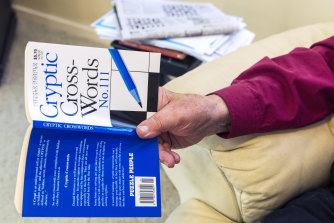 Donald Harrison with one of the many crossword books he has written for Puzzle People.