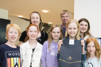 First coin strike winner Celeste Weerts with her family (from left) William Clissold, Emily Clissold, Sharon Clissold, Isabella Weerts, Trevor Weerts, Alicia Weerts and Isobelle Clissold at the Royal Australian Mint.