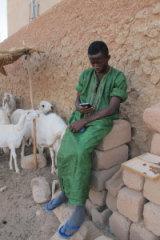 Migrant Idrissa Traore, 16, outside a compound in Agadez.