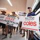 Coles and Aldi ditch $1 milk as farmers protest at Brisbane supermarket