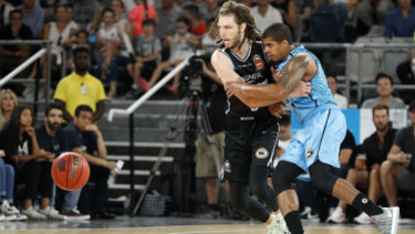 Craig Moller puts the pressure on Breakers playmaker Edgar Sosa.