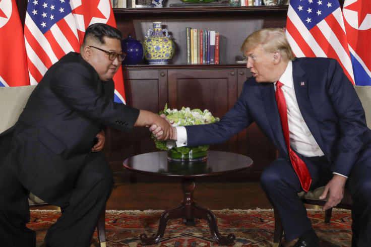 North Korea leader Kim Jong-un, left, and US President Donald Trump shake hands during their first meeting at the Capella resort on Sentosa Island in Singapore.
