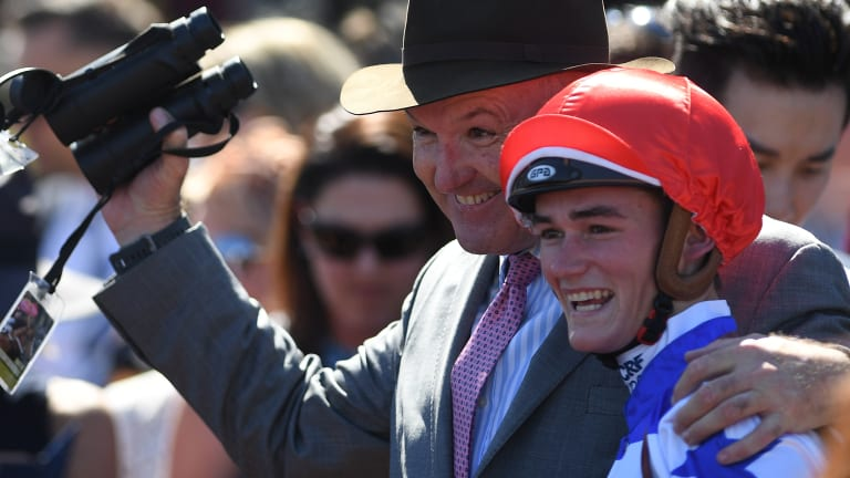 Trainer David Hayes (left) and jockey Regan Bayliss celebrate Redkirk Warrior's victory.