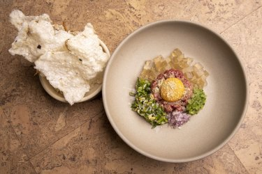 Beef tartare with egg yolk, pho jelly and anchovy tapioca crisps.